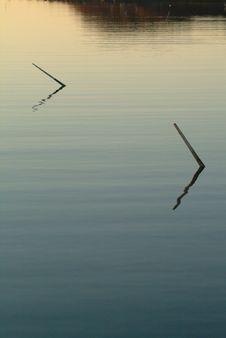 Free Pair Of Winter Mooring Sticks In Twilight Royalty Free Stock Photo - 835025