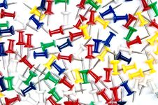 Colorful Pins Over The White Background Stock Image
