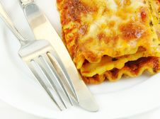 Free Lasagna Close Up With Fork And Knife Stock Photo - 8300880