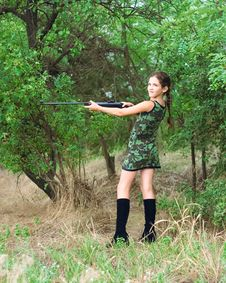 Beauty Teen Girl With Gun Royalty Free Stock Image