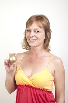Free Showing Her Golden Egg Stock Image - 8305621