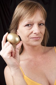 Showing Her Golden Egg Royalty Free Stock Image
