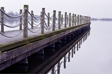Wooden Jetty On A Cold Lonely Morning Stock Photos