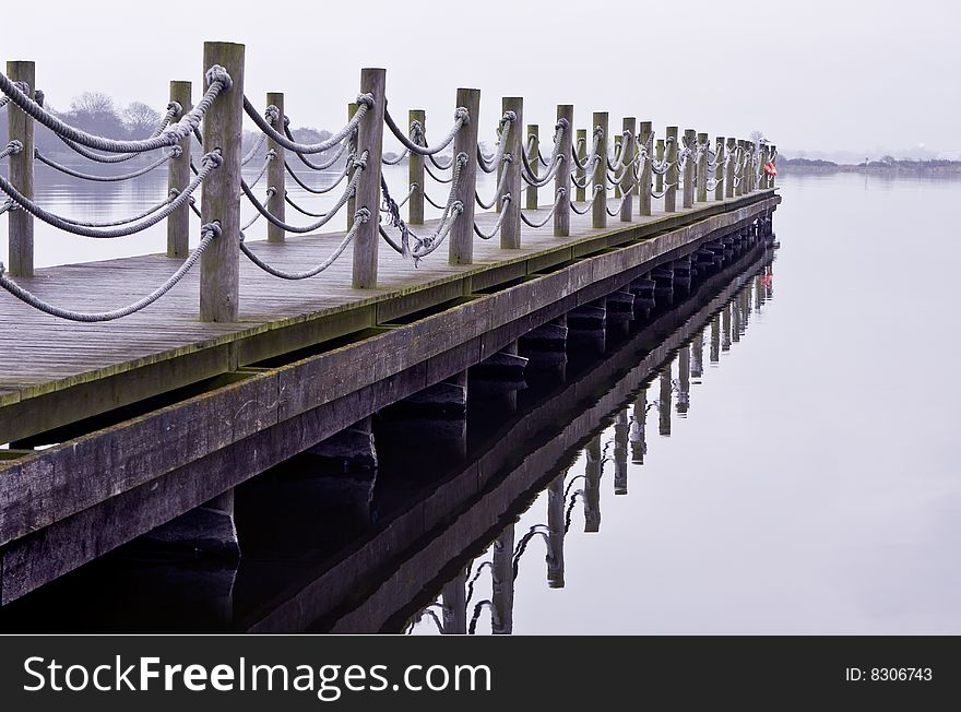 Wooden jetty on a cold lonely morning