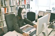 Free Person Wearing Scream Mask And Black Dress Shirt While Facing Computer Table During Daytime Royalty Free Stock Photography - 83007987