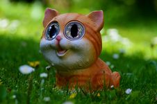 Free Yellow And Orange Tabby Kitten Figurine On Green Grass Plant Royalty Free Stock Photography - 83009617