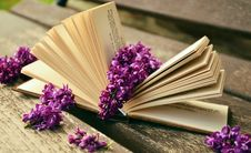 Free Lilac Flowers On Open Book Royalty Free Stock Images - 83009929