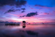 Free Tropical Stilt Houses In Sea At Sunset Stock Image - 83009991