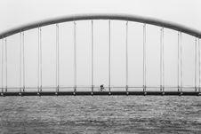 Free Cyclist On Suspension Bridge Over Sea Royalty Free Stock Photo - 83010005