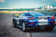 Free Silverstone Blue Silver Stripe Race Car On Track Royalty Free Stock Photography - 83010357