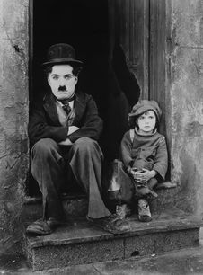 Free Charlie Chaplin And Boy Royalty Free Stock Image - 83010556