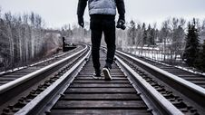 Free Person Walking On Railway During Day Time Royalty Free Stock Images - 83010839