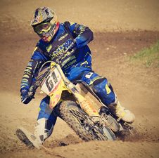 Free Man In Blue Motorcycle Suit Riding On Yellow Dirt Motorcycle During Daytime Royalty Free Stock Images - 83011359