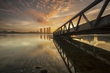 Free Bridge Over Sea With City Skyline At Sunset Royalty Free Stock Photography - 83012257