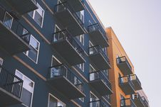 Free Blue High Rise Building Beside Brown Paint Building Royalty Free Stock Photos - 83012398