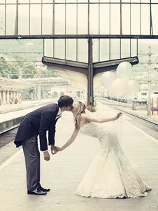 Free Couple Kissing Standing On The Train Waiting Platform Stock Photos - 83012493