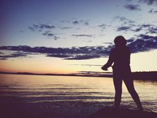 Free Silhouette Of Fisherman At Sunset Stock Image - 83012941