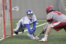 Free Person Wearing Blue Gloves Holding Lacrosse Stick Stock Images - 83013134