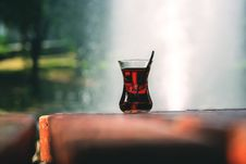 Free Clear Turkey Tea Glass With Tea On Brown Wooden Table Stock Images - 83013144