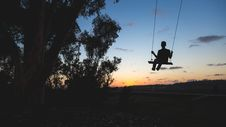 Free Man On Swing At Sunset Stock Photo - 83013160