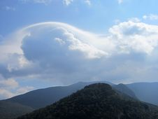 Free Clouds Over Mountains Stock Image - 83013211