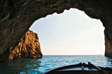 Free Boat In A Large Sea Cave Stock Image - 83013341