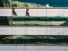 Free 3 People Hanging On White High Rise Building During Daytime Royalty Free Stock Images - 83013349