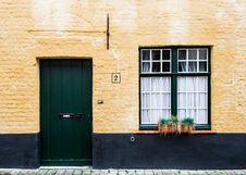 Free Green Wooden Door White Green Window Frame White Curtain Concrete House Stock Photos - 83013583