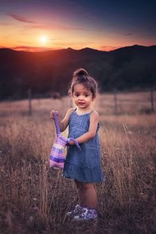 Free Small Girl On Grassy Field Stock Photos - 83013893
