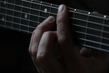 Free Person Playing Guitar And Holding The Cord Using Left Hand Royalty Free Stock Photography - 83013937