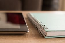 Free Notebook And Tablet On Desktop Stock Photo - 83013940