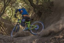 Free Man In Black And Orange Bicycle Riding Jacket With Green Off Road Bike Stock Image - 83014091