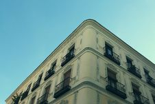 Free Apartment Building Against Blue Skies Stock Photography - 83014232