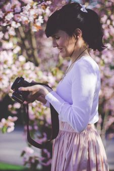 Free Woman In White Long Sleeve Top And Pink Skirt Holding Black Dslr Camera Royalty Free Stock Photography - 83014767