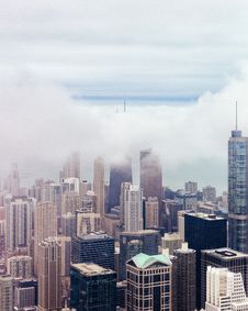 Free Clouds Over Urban Roof Tops Stock Images - 83014844