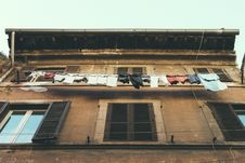 Free Hanging Clothes And Pants Beside Brown Building Royalty Free Stock Photography - 83015557