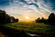 Free Sunset Over Rural Meadow Royalty Free Stock Photography - 83015867