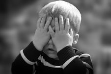 Free Boy In Black And White Sweater Covering His Face With His Tow Hand Stock Photos - 83015953
