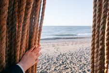 Free Person Holding Brown Rope On Beach Shore During Daytime Stock Photography - 83016352
