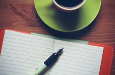 Free Fountain Pen On Top Of Notebook Beside Drinking Mug Stock Photos - 83016693