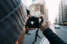 Free Photographer On City Streets Stock Photography - 83016982