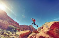 Free Man Jumping On Rocks In Desert Royalty Free Stock Photo - 83017865