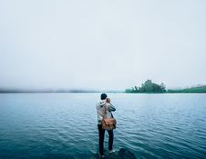Free Dark Haired Man Taking Picture Of Lake Royalty Free Stock Image - 83018096