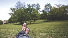 Free Person Lying On Grass Field Near Trees Under White Clouds During Daytime Stock Photography - 83018812