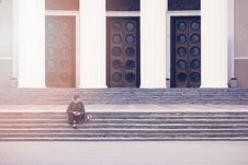 Free Man Sitting On A Concrete Stair Waiting For Someone During Daytime Royalty Free Stock Images - 83019209