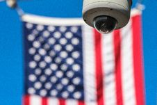 Free Surveillance Camera And American Flag Royalty Free Stock Photography - 83019307