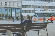 Free Commuter On City Bench Royalty Free Stock Photography - 83019327