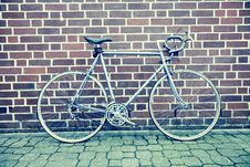 Free Teal And Black Road Bike Near Black And Brown Brick Wall Stock Image - 83019671