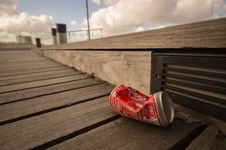 Free Coca-Cola Can On Boardwalk Royalty Free Stock Photo - 83020035