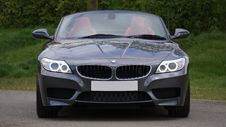 Free Black Bmw Convertible In Front Of Green Bushes Stock Photography - 83020122
